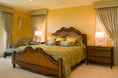 warm yellow home remodel, bedroom  #hhi #hhinteriors #remode #design #interiordesign #residential #bedroom #federalstyle #yellow #windowtreatments #wallaccents #paintings #federal #chairs #lounge #warm #carpet #crownmolding #basemolding #accentable #sidetable #lighting #bed #comforter #wood #lamps #greens #yellow