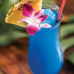 Blue Hawaiian 2 ounce Coconut rum  1 ounce blue Curacao liqueur  2 ounces pineapple juice  Serve over ice or blend