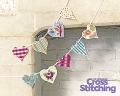 Try Something New - heart garland. Give #plasticcanvas a fab, fresh update with this super-easy idea to make a mix-and-match heart #bunting. So simple for beginners, and a great way to decorate your home! Look for the designs and 'how to' #tutorial only in The World of Cross Stitching magazine, issue 226