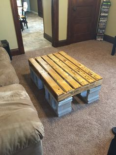 pallet and cinder block coffee table
