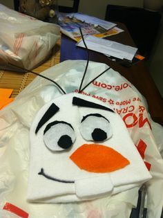 DIY: Olaf hat. Made for trunk or treating Frozen theme! Super easy, cheap and all from Walmart: $2 beanie, 23 cents per color felt, 88 cents for brown pipe cleaners, sharpie, tacky glue, scissors