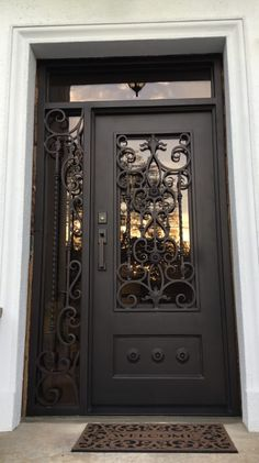 All of our doors are custom built to your exact dimensions. Please provide desired width and height for a free quote. Main Entrance Door Design, Door Gate Design, Front Door Design, Iron Front Door, Grill Door Design, Wrought Iron Doors, Metal Clock, Steel Doors, Exterior Doors