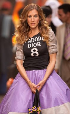In Sex and the City 2, Carrie makes a style statement in the Middle East wearing a designer tee, playful lavender full skirt and taupe patterned shrug. Only Carrie could pull this off