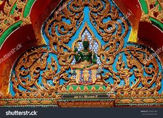 Nakhon Pathom, Thailand - December 27, 2005:  Green Seated Buddha with intricate gilded tracery on a temple pavilion at Wat Dai Lom