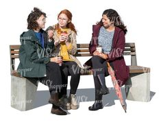 three cut out women sitting and talking in autumn