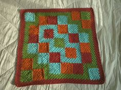 http://www.ravelry.com/projects/mio/eventually-granny-square-blanket-3