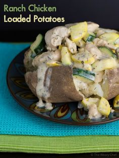 Baked potatoes smothered with chicken and vegetables in a creamy ranch sauce are a hearty, easy dinner!