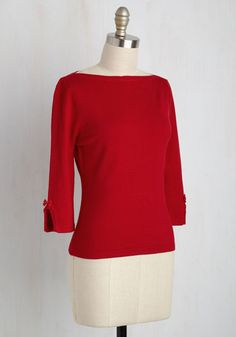 Living the local lifestyle of romance, great eats, and effortless sophistication is simple with this red sweater in your wardrobe! Retro-inflected with its bateau neckline, and offering a feminine touch with bow-topped, cropped sleeves, this top is the epitome of 'joie de vivre'.