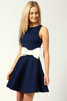 navy dress with a bow-cinched waist.