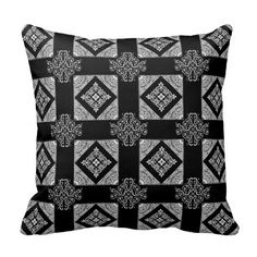Decorative ornamental throw pillow with a repeating pattern in black and white. The reverse side has the same design with the colors reversed! ©foreverprim