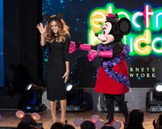 Sarah Jessica Parker gets into the Disney spirit of things celebrating Barneys's Electric Holiday