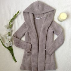 """VINCE Waffle Knit Hooded Cardigan Coat Easy-shaped, shawl-collar cardigan with an allover waffled texture in a soft easy to pair oatmeal color. Two front pockets. 3% Cashmere 97% alpaca/wool; dry clean or hand wash. Great used condition, but the fibers are fuzzy from wear, but still super soft and comfy! Approx flat meas: 23"""" length, 13"""" shoulders, 15"""" bust, 19.5"""" sleeves Vince Sweaters"""