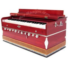 Harmonium Red Color 11 Stop Kail Wood (PDI-ABD) by buyRaagini.com. $315.00. Harmonium is an Indian musical instrument that resembles reed organ. The Harmonium is a small, manually-pumped musical instrument that uses fixed reeds for creating basic sounds.  Harmoniums consist of (reed banks) metal bands which vibrate when air flows over them, a pumping apparatus, stops for drones, and the keyboard. There are two types of harmonium: a foot-pumped version, and a hand-pumped p...