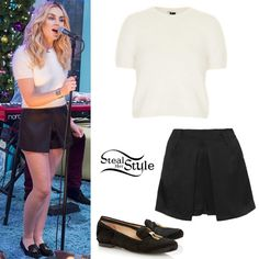 Perrie Edwards performed with her bandmates on Sunday Brunch wearing a Knitted Fluffy Jumper ($110.00), the Satin Back Skort ($70.00) and a pair of Genna Dune Black Pony Slippers ($278.00) all from Topshop. You can find a similar crop jumper for £17.99 at New Look and similar shoes from Steve Madden ($89.95).