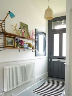 Victorian House, Dulwich London. Front door painted in Downpipe, painted wooden floors, vintage String shelving and Conran lamp. Interior Design by Imperfectinteriors.co.uk