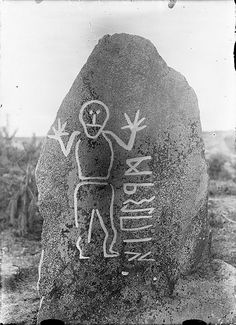 "Rune stone, Krogsta, Uppland, Sweden, from the 6th century AD, with a human figure and an inscription. One of three known rune stones in Uppland carved with the elder rune alphabet, and the only one still in its original position. The inscription is only partly deciphered - the text on the backside probably renders the word ""stone"".  Photo taken ca. 1900"