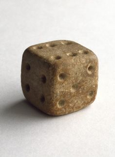 Terracotta dice  Mohenjo-daro, 2500 - 1900 BC, Gaming with dice has always been popular in India. This Indus cubical die is unusual in that its opposite sides add up to seven as in modern dice.