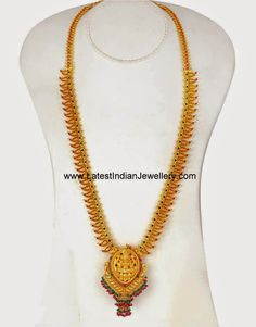 Long mango mala in 22 karat gold studded with rubies and emeralds is attached to a designer Lakshmi gold pendant embellished with ruby and emerald drops Gold Bangles Design, Gold Earrings Designs, Gold Jewellery Design, Necklace Designs, Gold Haram Designs, Gold Temple Jewellery, Gold Wedding Jewelry, Gold Jewelry, Gold Necklace