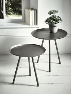 With three round tapered legs and a smooth lipped top, our pair of different sized tables are made from weighty iron with a stylish antique zinc finish. The perfect metallic accent for an industrial-inspired interior, they can easily be softened with a leafy potted plant or vase of faux flowers.