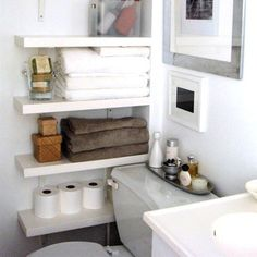 Tiny bathrooms need an extra dose of creative planning, and dead wall space beside—or above—the toilet should not go to waste. Add several narrow shelves to maximize your storage options. Secure wall brackets to mount traditional shelves or consider floating shelves for a sleeker look.