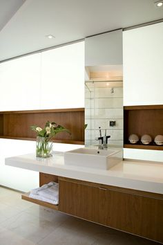"Excellent: Background light and the wood furniture ""inside"" the wall Good: Floor (very clean) and the white countertop and sink positioning (on top of counter) Careful: Can't have a flat sink (easily stains because water doesn't run fully)"