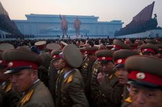 Pyongyang, North Korea: Military members walk past two statues of the late leaders Kim Il Sung and Kim Jong Il after an unveiling ceremony. (David Guttenfelder / AP Photo)