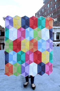Have you heard about the new Jaybird Quilts pattern Disco? It's a stunning design that uses the Hex N More ruler (also by Jaybird Quilts), and Julie made a Disco quilt using our Confetti Dots collection! We featured the quilt in the center of our booth at Quilt Market and it was certainly turning heads. This colorful version of the pattern looks like jewels!