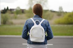 white backpack jeans jacket