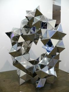 A geometric sculpture using triangles. This is an interesting concept that creates a different impact of the viewer.