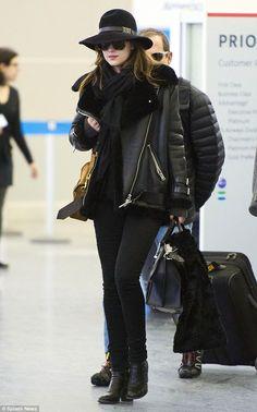 Arrivals: Dakota Johnson arrived at New York's JFK airport on Monday following the Oscars ...
