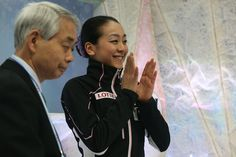 Mao Asada of Japan celebrates her score with her coach Nobuo Sato after her routine in the Ladies Short Program during ISU World Figure Skating Championships at Saitama Super Arena on March 27, 2014 in Saitama, Japan.