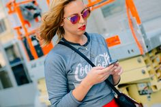 Name Game: Graphic Logos Mirrored sunglasses dressed up a Coca-Cola raglan sweatshirt.
