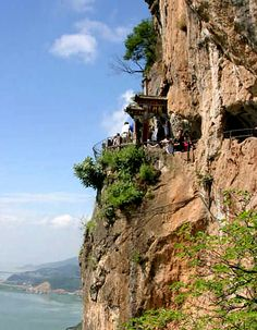 western hills & dragon gate: kunming, (yunnan province), china. cut out of the side of a cliff, the dragon gate is the highest temple of the western hills (2,500 meters above sea level) and is composed of grottoes, sculptures, corridors, & pavilions. breath-taking views of dianchi lake & the city of kunming.