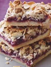 Barefoot Contessa - Raspberry Crumble Bars (made with a shortbread crust mixed with granola, topped with raspberry preserves, slivered almonds & more of the shortbread/granola crust) Köstliche Desserts, Delicious Desserts, Dessert Recipes, Yummy Food, Fondue Recipes, Kabob Recipes, Health Desserts, Drink Recipes, Raspberry Bars
