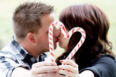 I like the candy cane concept but not covering our faces and also maybe not a kissing picture...