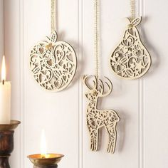 Fretwork Christmas Shape Christmas Decorations bring some festive sparkle to  a plain wall.