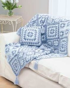 Create a matching granny square throw and pillow in the soft blue colors of denim with this granny square crochet pattern from Bernat Yarns. This is a lovely, warm throw for any room.