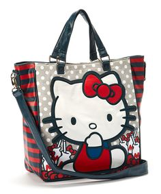 Full of classic charm, this darling tote is perfect for taking out on the town. Featuring Hello Kitty's adorable figure and a removable shoulder strap for easy transport, it's a fully functional and fashionable accessory for everyday use.