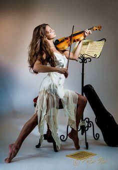 The Violinista was a collabaration with a favorite model and me. We set out to emulate a whispy, feminine and lyrical image using soft lighting, hourglass shapes and dynamic posing. Montage Photo, Music Photo, Sound Of Music, Belle Photo, Instruments, Gifs, Lady, Photos, Violin Photography
