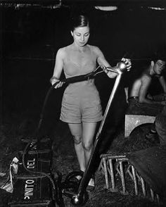 Pinito del Oro packing her trapeze backstage at Ringling Bros. and Barnum & Bailey Circus (c.1955)