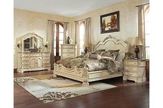 """The Ortanique Sleigh Bedroom Set from Ashley Furniture HomeStore (AFHS.com). The exquisite Old World beauty of the """"Ortanique"""" bedroom collection comes to life with the opulent white finish flowing smoothly over the elaborately moulded ornamentation all of which is perfectly complemented by the natural marble parquetry tops of the dresser and night stand create an elegant atmosphere for any bedroom décor."""