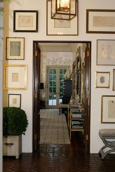 As much as I love clean, uncluttered white walls, I'm always drawn to a beautifully arranged gallery wall of art and the personal story it tells about the homeowner. {Image via Windsor Smith}