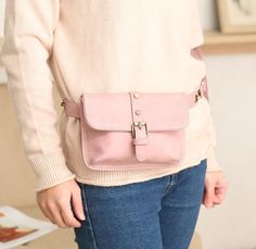 Staying in style this season is easy with this hands-free belt bag. Featuring a solid pattern, gold tone buckle and hardware, interior pockets, and a snap closure. Choose from pink, khaki or black. From our fabulous handbags and accessories. Designer Belt Bag, Hip Purse, Leather Belt Bag, Waist Pack, Trendy Clothes For Women, Leather Design, Latest Fashion For Women, Plus Size Outfits, Belt Bags