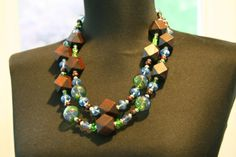 Hand blown glass and faceted wood necklace by Beauje on Etsy, $40.00