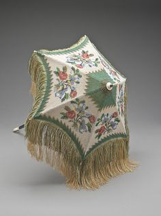 Brocade parasol with fringe on wooden folding handle, 1860's