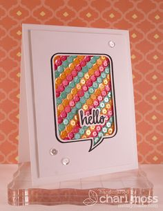 Sequin- filled Hello card, by Chari Moss