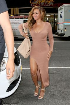 Famous legs: Beyonce, 33, flaunted her famous figure on Tuesday in New York while wearing a split leg dress