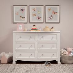 The Kalani 6-drawer dresser is the smart storage solution for the classic Kalani, Emily and Porter nursery collections. Six spacious drawers provide ample storage to organize all of baby's necessities, while its thoughtful design ensures a style fit for any nursery or bedroom. Brilliant details of this double dresser include recessed front drawer panels, a gently curved apron front and curved top sides. Wide Dresser, 6 Drawer Dresser, Double Dresser, Drawer Knobs, Butterfly Baby Room, Wooden Drawers, Smart Storage, Baby Safety, At Home Store