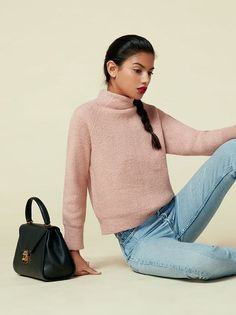 Cozy up.  This is a relaxed fitting, hip length sweater with a turtleneck.
