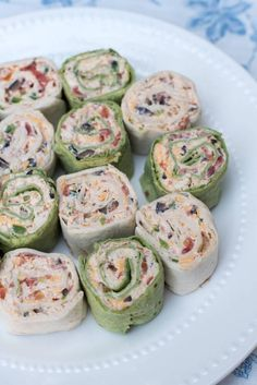 The classic party appetizer with a Southwest twist. These pretty Southwest Chicken Tortilla Pinwheels are made ahead and are waiting for you in the refrigerator to slice and serve at party time. A great addition to your appetizer menu at any time of year. Apéritifs Pinwheel, Pinwheel Recipes, Chicken Pinwheels, Tortilla Pinwheels, Tortilla Pinwheel Appetizers, Mexican Pinwheels, Pinwheels Food, Tortilla Rolls, Appetizer Recipes